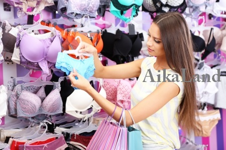 22415882 - beautiful young woman in shop with underwear